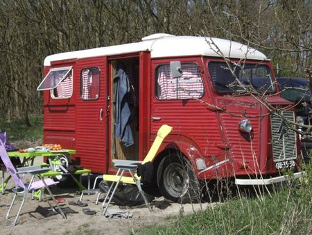 Red and white citroen bus front and side view